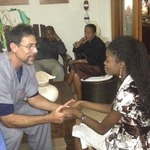 Dr. Hart speaks with Haitian medical student