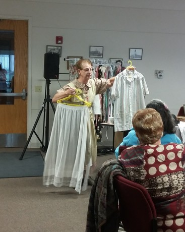 Yvonne Cory shows aprons