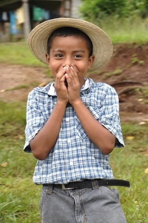 This was one boy's reaction when he saw the pickups full of boxes arriving in his little community. Courtesy Jennifer C