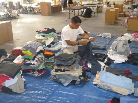 Sorting mens' clothing.