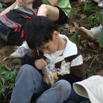 Little boy having lunch in a bush!!