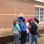 Students selecting plants