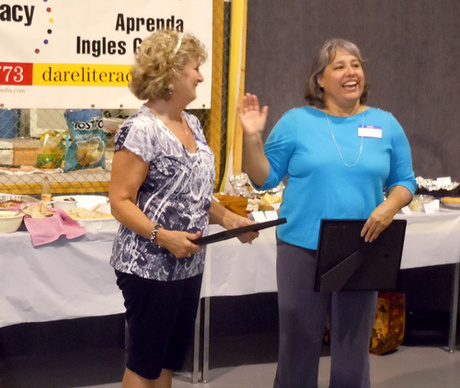 Former board member, Susan Estrella, receives Certificate of Appreciation from ESL Coordinator Jovita Drake.