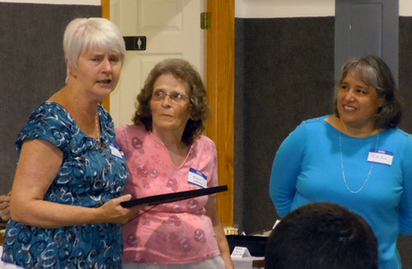Former board member, Elaine Dawson (center), receives Certificate of Appreciation from Board Chair Lynn Blackburn (L) and ESL Coordinator Jovita...