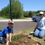 Cub Scout Ryley Goyette and his mom Tara Corcoran help to beautify the parking lot area on Center Street in Bellingham.