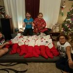 Grand_daughters_prepare_stockings_for_the_code_purple_guests_2016_christmas