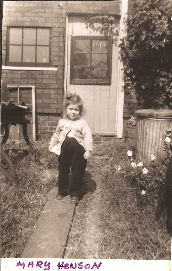 MARY HAZEL HENSON IN BACK YARD HOUSE ON MAIN